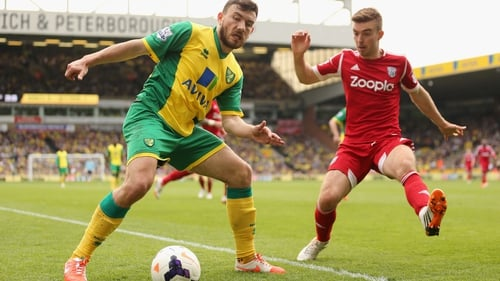 James Morrison (R) of West Brom closes down Norwich's Robert Snodgrass
