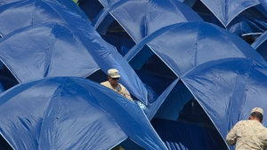 View of tents for families camping on the Carlos Dittborn stadium in Arica, 2050 km north of Santiago on April 5, 2014 in fear their homes might collapse. Life was gradually returning to normal in quake-hit Chile officials said on the eve, with power rest