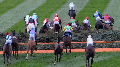 Runners and Riders jump Valentine's during the Crabbie's Grand National Steeple Chase at Aintree Racecourse in Liverpool, England