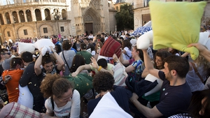 People hit each other with pillows during an event dubbed International Pillow Fight Day in Valencia  as part of the event created in 2008