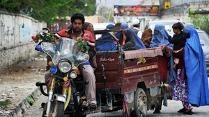 Women travel by rickshaw to cast their vote in Afghanistan