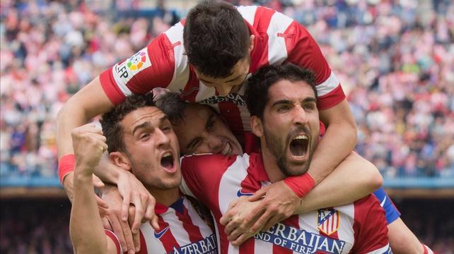 Raul Garcia (R) of Atletico de Madrid celebrates scoring with teammates Koke, Diego Godin and David Villa