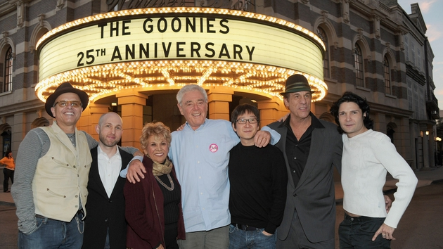 Richard Donner (centre) and some of the cast of The Goonies celebrating the film's 25th anniversary