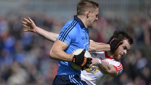 Dublin's Eoghan O'Gara fends off the challenge of Ronan McNamee of Tyrone