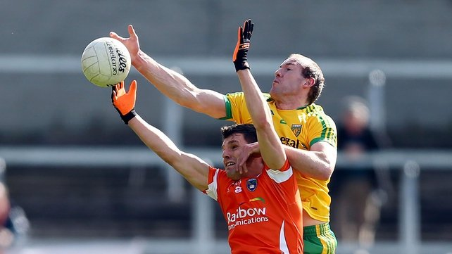 Armagh's Stephen Harold and Donegal's Neil Gallagher battle for the ball