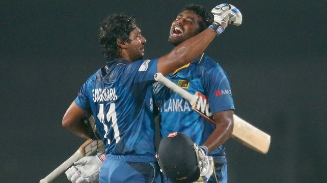Kumar Sangakkara and Thisara Perera of Sri Lanka celebrate