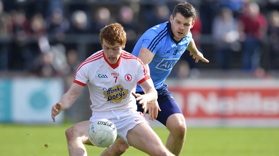 Tyrone's Peter Harte and Kevin McManamon of Dublin have eyes on the ball in Omagh