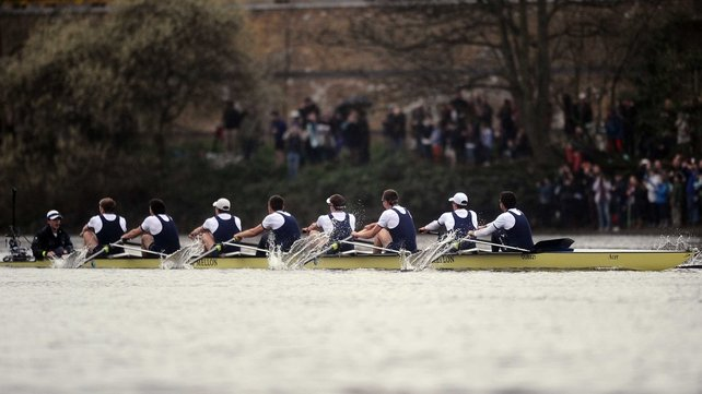 The victorious Oxford crew cross the finish line on the River Thames