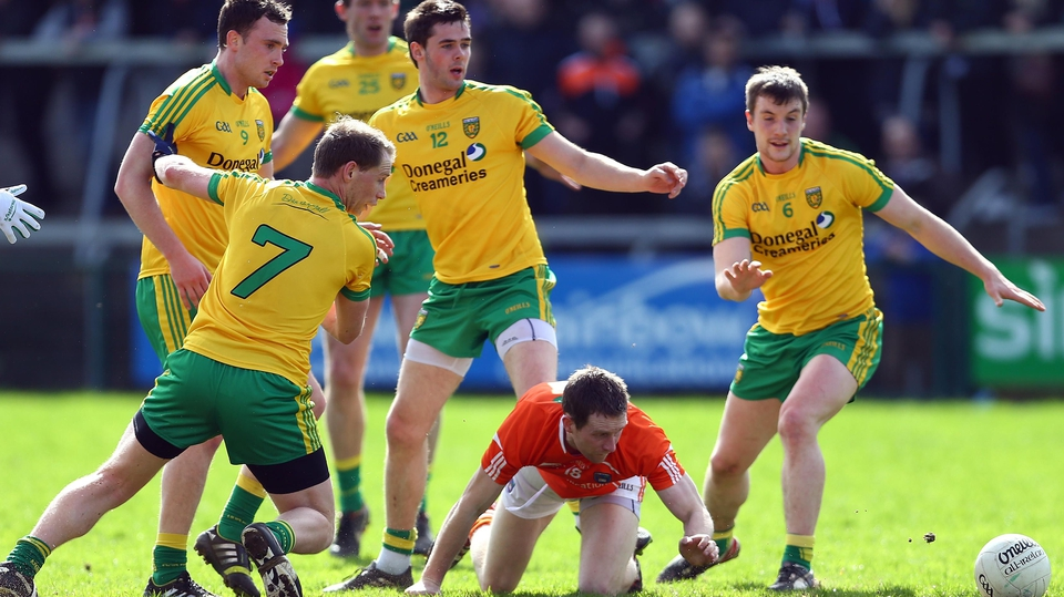 Armagh's Finnian Moriarty is surrounded by Donegal players at the Athletic Grounds