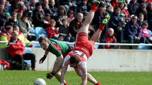 James Kearney from Derry in an acrobatic pose at McHale Park with Ger Cafferkey watching on