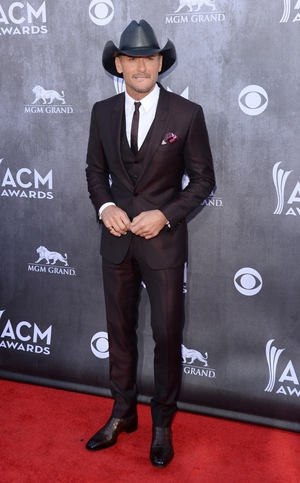 Tim McGraw looked sleek and stylish in his suit and stetson