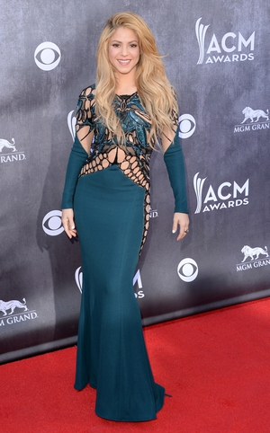 Shakira arrived in a full length gown with cut-out panels