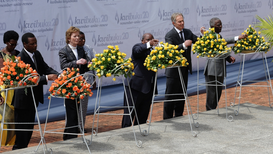 Dignitaries, including former President Mary Robinson, lay wreaths at a ceremony in Rwanda