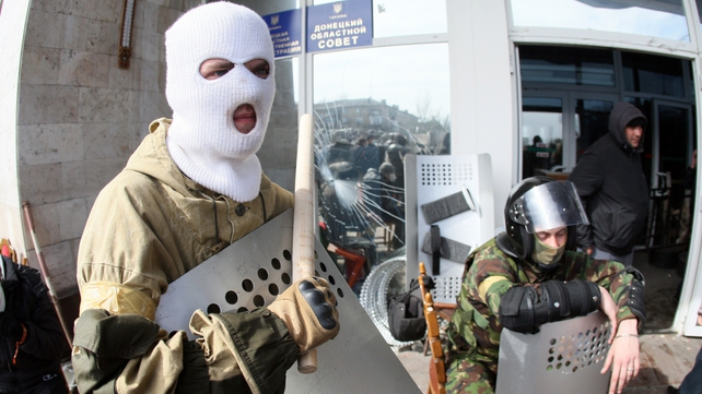 Activists guard the main administrative building in the city of Donetsk