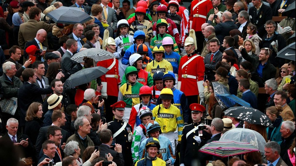 Jockeys make their way out for the start of the National