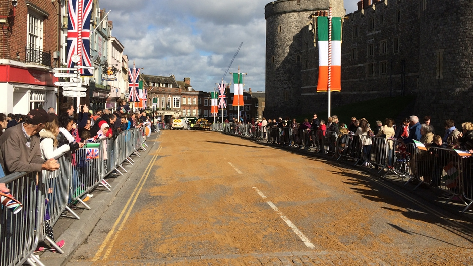 Crowds gather in Windsor to see the presidential party along with Prince Charles and his wife process in carriages to Windsor Castle