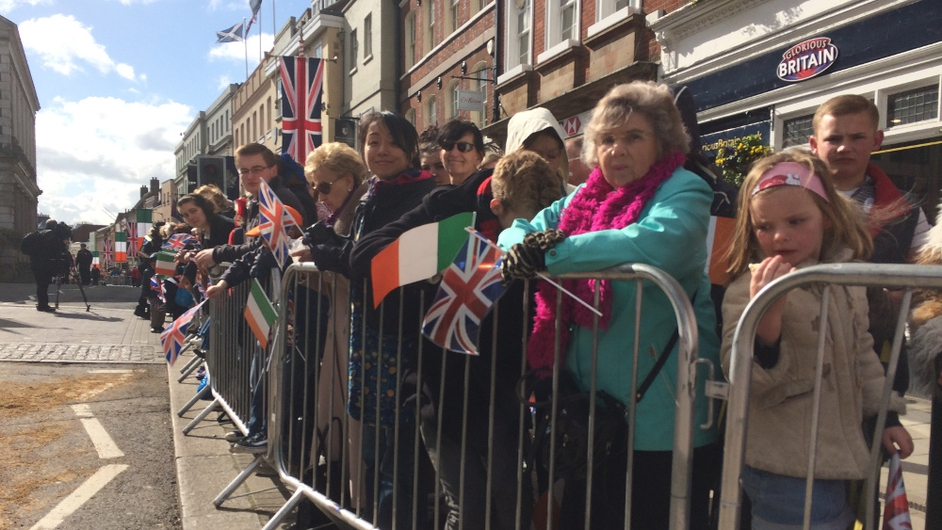 Flags aplenty as people wait for the royal procession