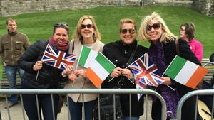 Tourists gather to view the royal procession in Windsor
