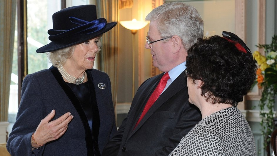 Tánaiste Eamon Gilmore and his wife chat to the Duchess of Cornwall at the Irish Embassy