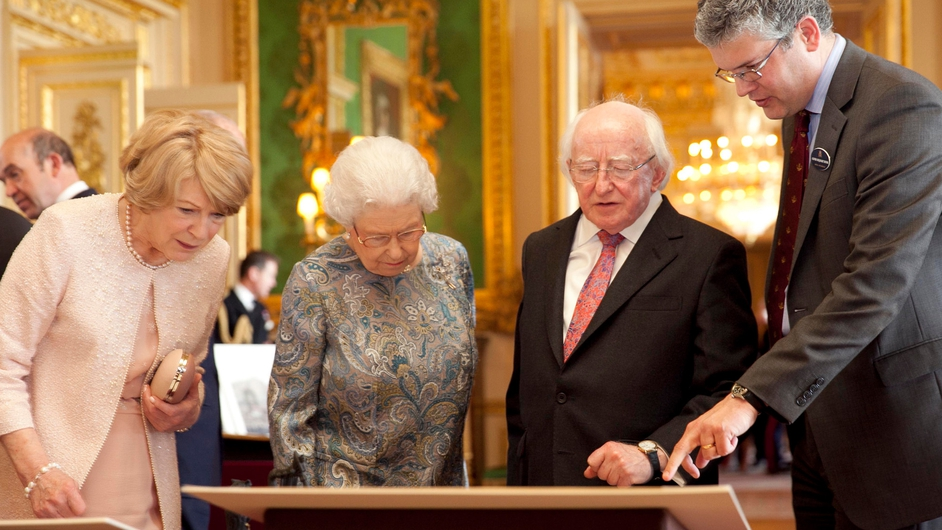 The President and his wife, along with Queen Elizabeth are shown Irish-related items from the Royal Collection