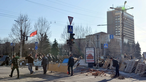 Pro-Russian activists reinforce a barricade in front of the security service headquarters in Luhansk