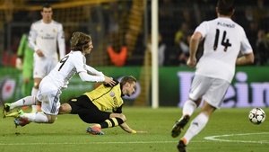 Dortmund's defender Oliver Kirch (C) and Real Madrid's Croatian midfielder Luka Modric