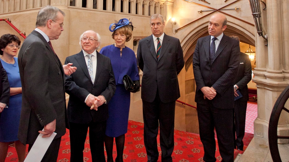 President Higgins and his wife Sabina listen to David Rankin-Hunt as the history of the regimental standards is explained