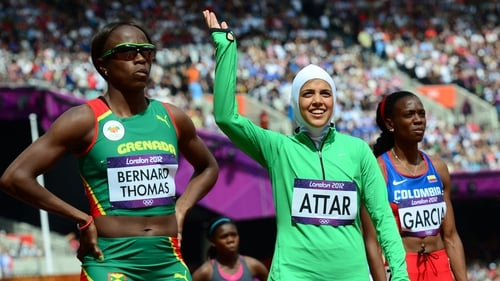 Saudi Arabia's Sarah Attar (C) at the end of the women's 800m heats at the London Olympics
