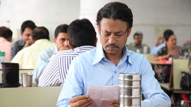 Burn after reading - Saajan (Irrfan Khan) reads the included note before he tucks into lunch cooked by a stranger.