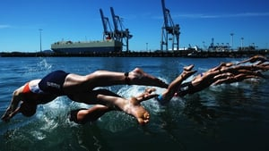 Competitors dive during the ITU World Triathlon elite women's race in Auckland, New Zealand
