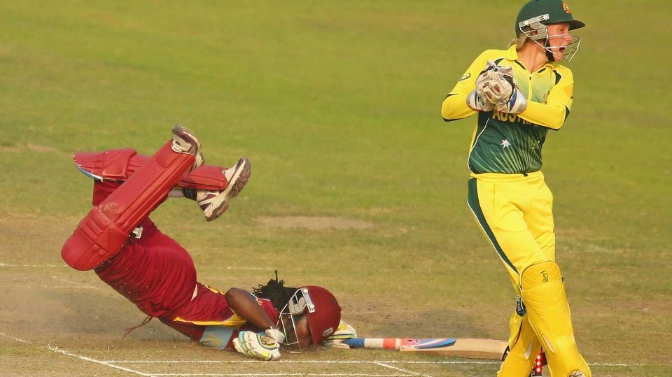 Stafanie Taylor of the West Indies dives but is run out by Alyssa Healy of Australia during the ICC Women's World Twenty20 in Bangladesh