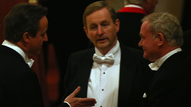 Martin McGuinness (right) talks with David Cameron (left) and Enda Kenny in Windsor