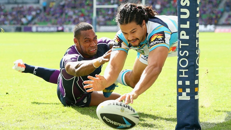 Kevin Gordon of the Titans scores a try against the Melbourne Storm at AAMI Park