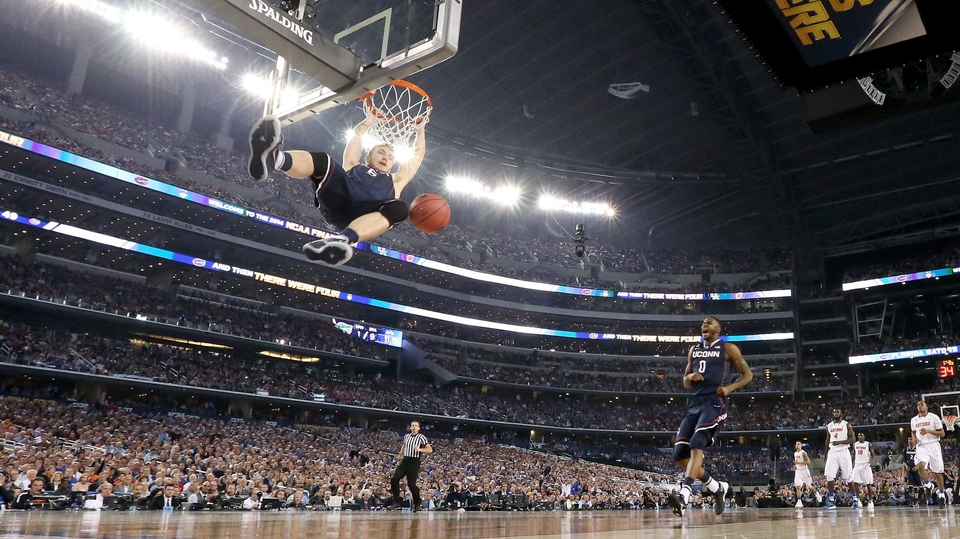 Niels Giffey of the Connecticut Huskies dunks against the Florida Gators in Arlington, Texas