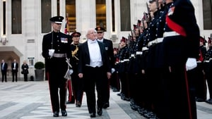 President Higgins inspects a guard of honour ahead of the gala dinner