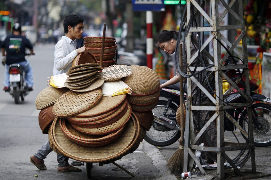A man sells baskets at a street in Hanoi, Vietnam