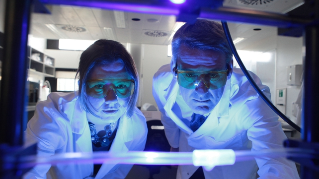 EI Project team member Caroline Gaynor and Prof Larry Egan,  observing a UV curing system for a luer connector