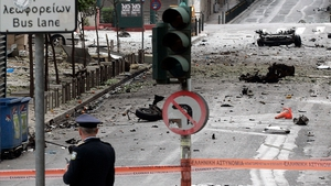 The scene is sealed off after a car bomb explodes in Athens, Greece