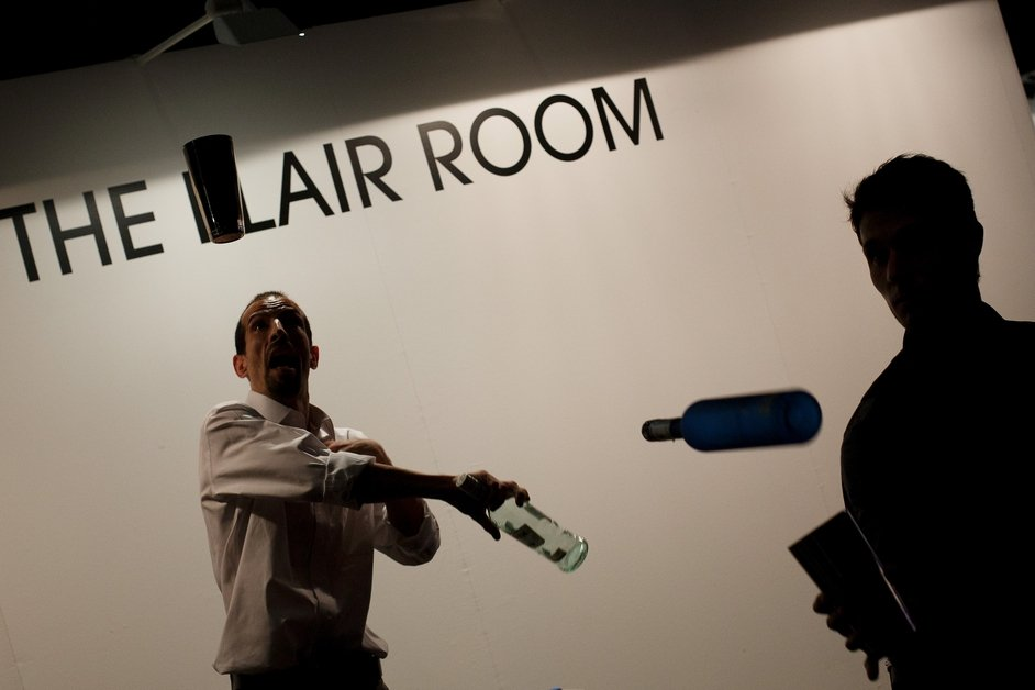 A bartender juggles with bottles during the Mix&Shake congress in Madrid, Spain