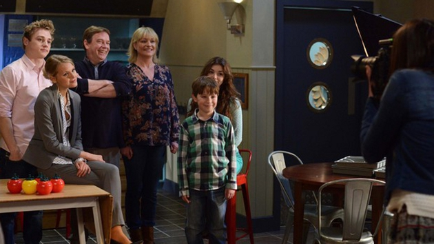 Jane awkwardly joins the Beale family photograph