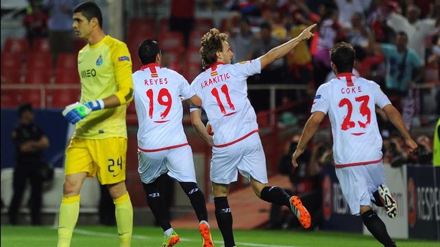 Sevilla's Swiss midfielder Ivan Rakitic (2ndR) celebrates after scoring