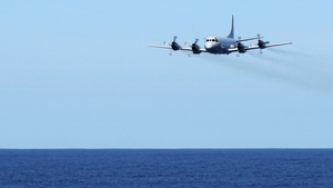 A Royal Australian Air Force plane conducts a low-level fly in the search for Flight MH370