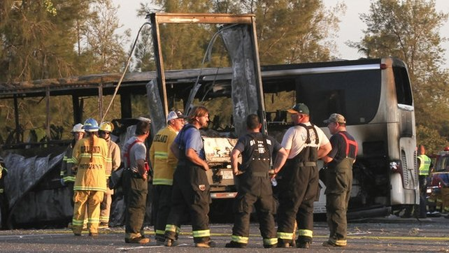Pictures showed the bus reduced to a burned-out chassis resting sideways across the highway