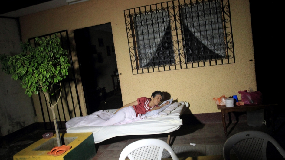 A woman sleeps outside her house after a 6.2 magnitude earthquake, in Nagarote, Nicaragua (Pic: EPA)