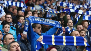 Cardiff fans show their allegance to the old team colours by waving blue and white scarves during their clash with Crystal Palace
