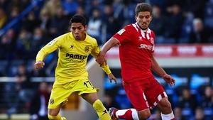 Aquino (L) of Villarreal competes with Daniel Carrico of Sevilla during a La Liga match last December