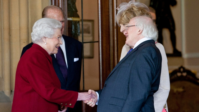 Queen Elizabeth and President Higgins shake hands as the President and his wife leave Windsor Castle