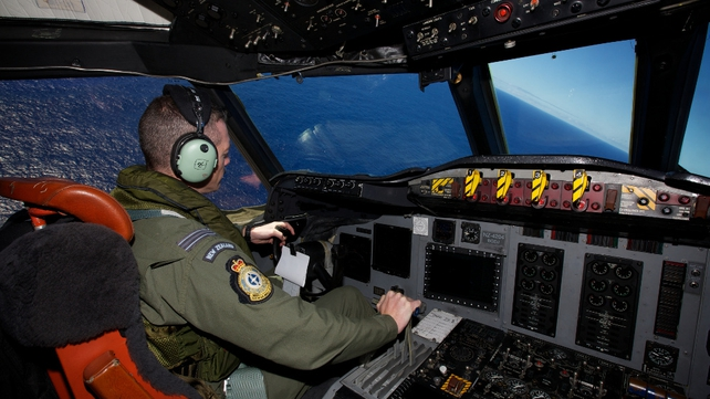 Tim McAlevey of the Royal New Zealand Air Force flying a P-3 Orion during a search to locate missing Malaysia Airways Flight MH370