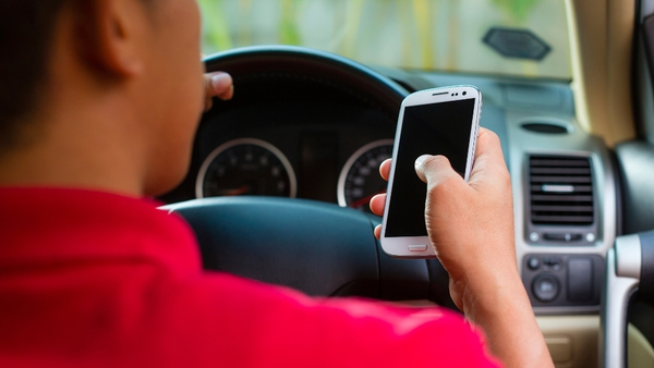 Drivers will be penalised for texting or accessing information on their phones