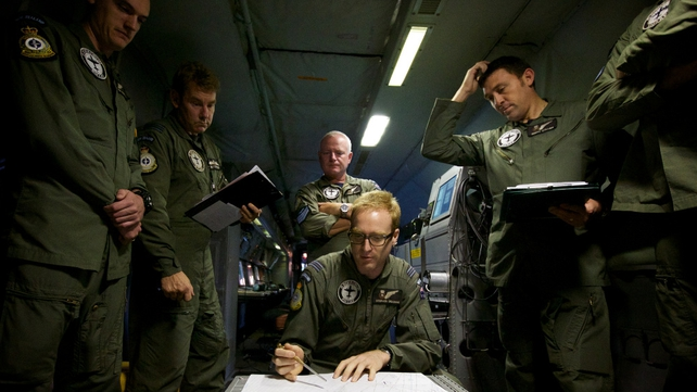 New Zealand air force officers hold a pre-flight meeting ahead of their search mission